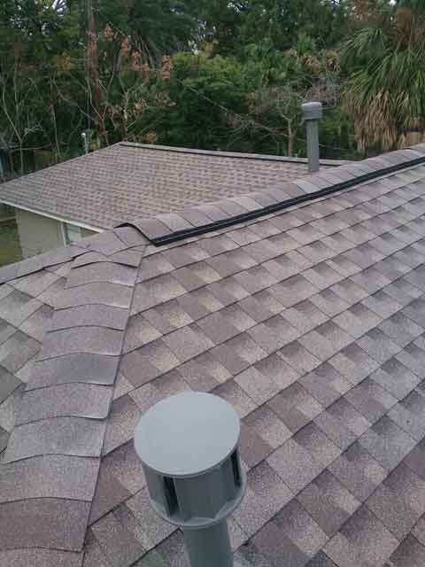 Shingles and ridge vents and chimney caps...