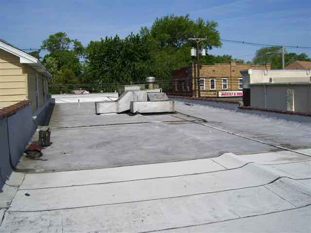 Preparing to roll out a flat roof
